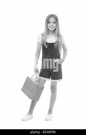 Kids designer clothing summer sale. Girl cute teenager carries shopping bag. Kid bought clothing summer sale. Sale benefits. Seasonal sale concept. Girls absolutely fond of shopping. - Stock Photo