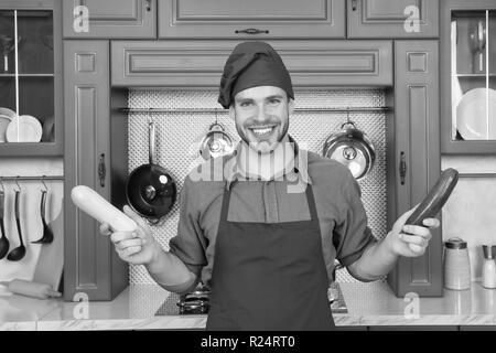 Substitute carefully. Although substitutions seem obvious they can be tricky business. Ruined dish is waste of time. Man chef substitutes marrow with zucchini. Chef smiling knows kitchen tricks. - Stock Photo