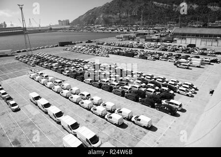 Barcelona, Spain - March 30, 2016: rows of cars on parking in sea port. Car export and import business. Car shipment. Shipping activity. Trade and car commerce. - Stock Photo