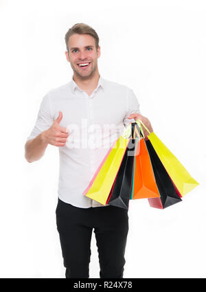 Black friday sale concept. Man formal clothes carry shopping bags. Guy happy carry bunch shopping bags. Profitable deals on black friday. Man hold lot paper bags packages after shopping in mall.