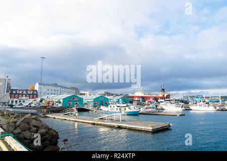 Reykjavik, Iceland - October 13, 2017: ships at sea coast. Travel by ship. It is dear to ship it here. Travel east travel west, after all home is best. - Stock Photo