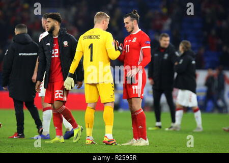 16th November 2018, the UEFA Nations League match Wales v Denmark at the Cardiff City Stadium. In yellow Kasper Peter Schmeichel is a Danish professional footballer who plays as a goalkeeper for Premier League club Leicester City and the Denmark national team seen here shaking hands with Gareth Bale of Wales at the end of the game. News use only. Credit: www.garethjohn.uk/Alamy Live News - Stock Photo