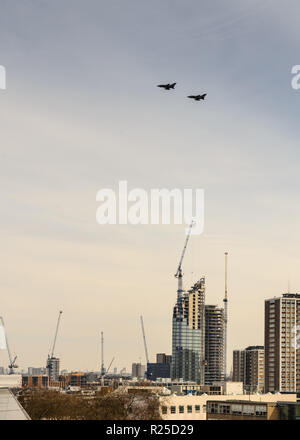 London, England, UK - March 13, 2015: Fighter jets race over North London as part of a commemorative flypast. - Stock Photo