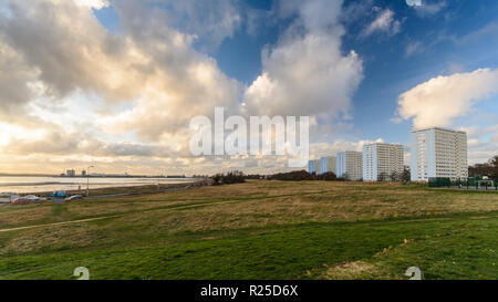 Southampton, England, UK - February 16, 2014: A row of five mid-20th century social housing apartment blocks stand in parkland at Weston Shore beside  - Stock Photo