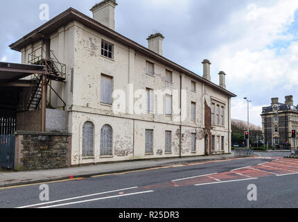 Cardiff, Wales, UK - March 17, 2013: The derelict station house at Cardiff Bay, terminus of the small Butetown Branch Line railway, stands boarded up  - Stock Photo