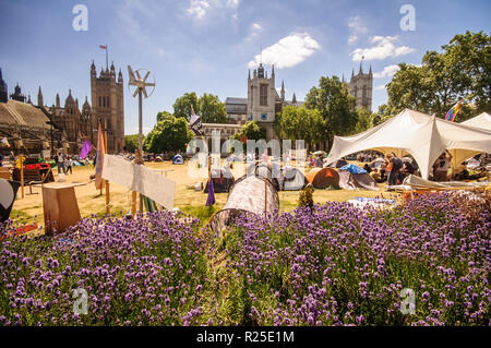 London, England, UK - July 4, 2010: The Democracy Village protest camp occupies Parliament Square, outside the Houses of Parliament and Westminster Ab - Stock Photo