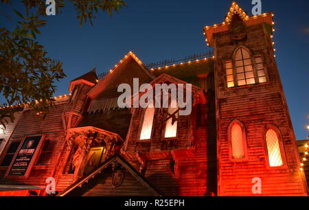 Orlando, Florida. October 31, 2018. Haunted house attraction at Kissimmee Old Town at night. - Stock Photo