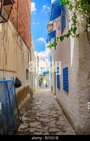 Narrow street with white houses in Hammamet Tunisia. - Stock Photo