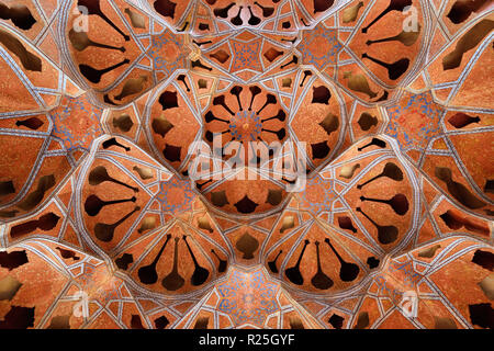 ESFAHAN, IRAN - 26 OCTOBER 2018: Patterned ceiling contrasts with shapes of music instruments in Ali Qapu Palace, situated at Naqsh e Jahan Square - Stock Photo