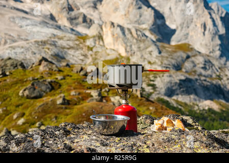 Tourist equipment and tools: camping gas on mountain background - Stock Photo