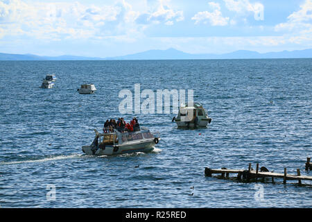 Ferry boats with many people on the Lake Titicaca, the town of Copacabana, Bolivia on 28th April 2018 - Stock Photo