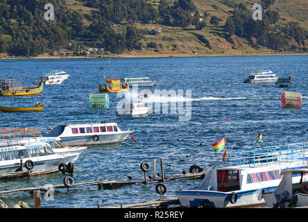 People playing jet ski among many boats on the Lake Titicaca, the town of Copacabana, Bolivia on 28th April 2018 - Stock Photo