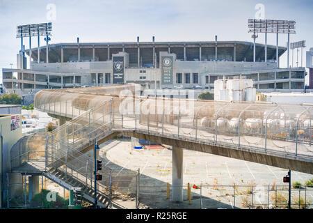 November 19, 2017 Oakland/CA/USA - Pedestrian bridge connecting the BART stop and Oakland–Alameda County Coliseum complex, a multi purpose stadium, Sa - Stock Photo
