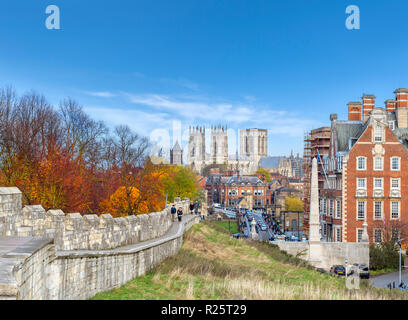 View along the York City Walls towards York Minster (York Cathedral), York, England, UK - Stock Photo