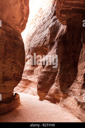 Sandstone cliffs in the Siq Gorge, entrance to the Nabataean city of Petra, near Wadi Musa, Jordan - Stock Photo