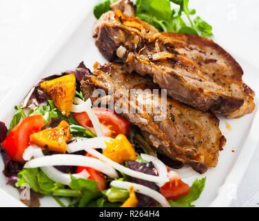 grilled pork t bone steak garnished with mashed potatoes and tomato stock photo 127692881 alamy. Black Bedroom Furniture Sets. Home Design Ideas