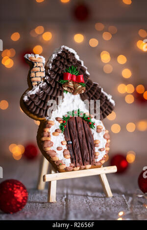 gingerbread house on stand - Stock Photo