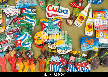 CIENFUEGOS, CUBA - JANUARY 3, 2017: Cuban national flags, palm, Che Guevera portraits and other fridge magnet / souvenirs typical for Cuba sold in sou - Stock Photo