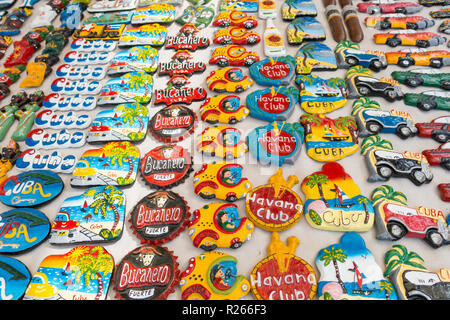 TRINIDAD, CUBA - JANUARY 4, 2017: Cuban national flags, palm, Che Guevera portraits and other fridge magnet / souvenirs typical for Cuba sold in souve - Stock Photo