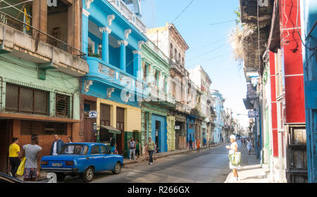 HAVANA, CUBA - JANUARY 16, 2017: Street scene with colorful buildings and old american car in downtown Havana, Cuba - Stock Photo