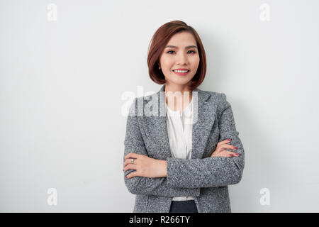 Entrepreneur young asian woman, business woman arms crossed on white background. - Stock Photo