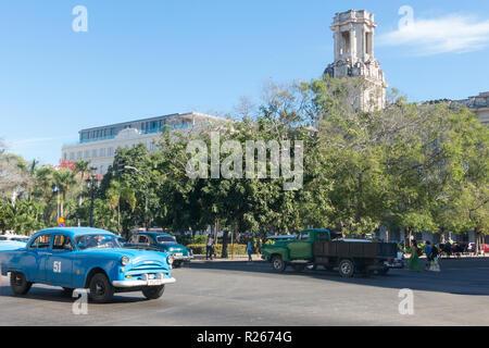 HAVANA, CUBA - JANUARY 16, 2017: Street scene with old american car in downtown Havana, Cuba - Stock Photo