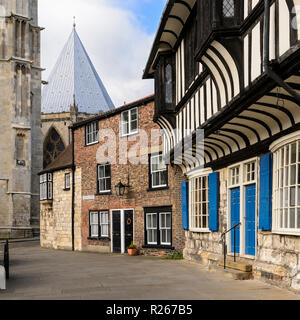 Partial view of 4 historic buildings (York Minster, half-timbered St. William's College & houses) - College Street, York, Yorkshire, England, UK. - Stock Photo