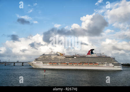 Miami, USA - December 27, 2015: Beautiful marine view with one large cruise liner ship of Carnival cruise line in port going to destination on cloudy blue sky backgroundat Miami, Florida - Stock Photo