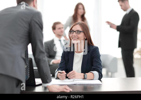 Young businessman explaining something - Stock Photo