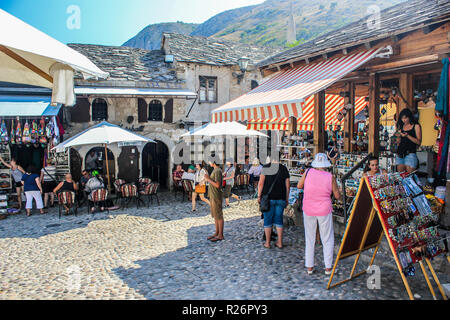 August 2013, Mostar.  Tourists relaxing & shopping in the cobbled streets in the historic part of the city. - Stock Photo