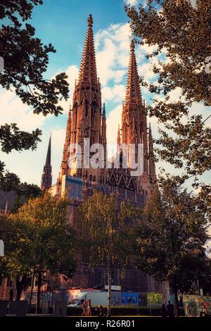 Vienna, Austria, July 2018.   The Votive Church (Votivkirche) in Sigmund Freud Park. - Stock Photo