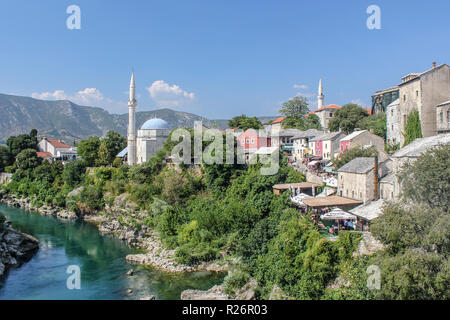 August 2013, Mostar. View of the Koski Mehmed Pasha Mosque and the old city of Mostar on the bank of the River Neretva as seen from the Old Bridge - Stock Photo