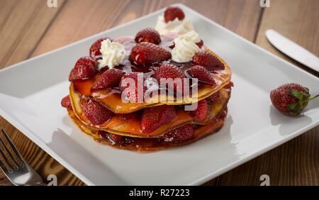 Image result for white chocolate coconut pancakes directions Make a well in the center and pour in the milk, egg and melted butter; mix until smooth. - Stock Photo
