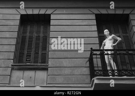 Mannequin on balcony of abandoned house. Black and white. - Stock Photo