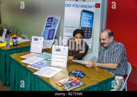 Miami Beach Miami Florida Dade College Wolfson Campus Open House education exhibitor display brochures Black woman man senior co - Stock Photo