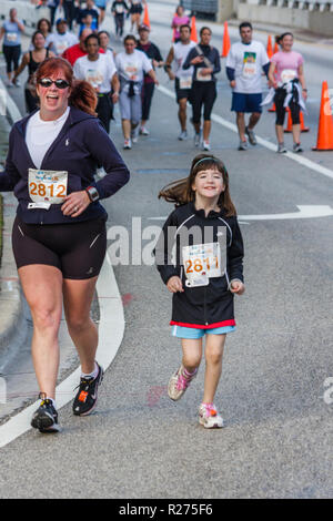Miami Beach Florida Blue Cross and Blue Shield Tropical 5K Run race runner walking sports fitness woman girl mother daughter roa - Stock Photo