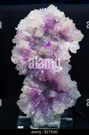 Amethyst and clear quartz crystals in cluster. - Stock Photo