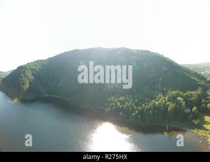 aerial shot of a lake in wales - Stock Photo
