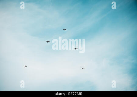 Jet aircrafts aerobatic group silhouette. Aerobatic group formation at blue sky during Air Show background with copy space - Stock Photo