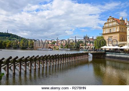 View from quayside towards Prague Castle, summer - Stock Photo