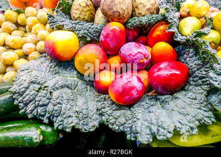 Fresh mango fruit on vegetable market stall, Alicante Spain - Stock Photo