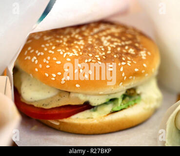 Photo background bright macro beautiful burger with vegetables and cheese on - Stock Photo