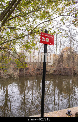 No swimming sign on the banks of the river weaver in Winsford Cheshire UK - Stock Photo
