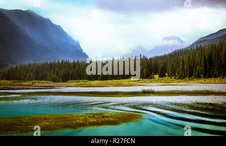 Mountain Valley Waterway. Colorful view of the Hyalite Reservoir, Montana, USA. Vintage stylized landscape background with copy space. - Stock Photo