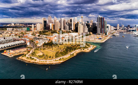 Millers point on shore of Sydney Harbour at The Rocks historic suburb in front of High-rise towers of city CBD and Barangaroo. - Stock Photo