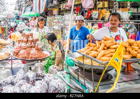 Bangkok, Thailand - 6th October 2018: Street vendors selling various food. There are still many mobile street vendors in the city. - Stock Photo