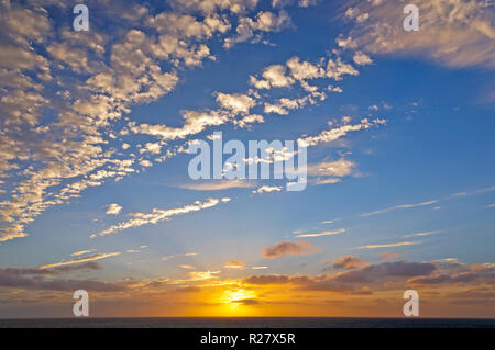 Sunset Clouds over the English Channel - Stock Photo