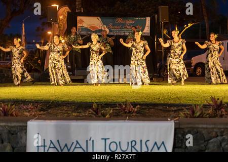 Kailua-Kona, Hawaii - The dancers of Halau Ka'eaikahelelani perform traditional hula at the Coconut Grove Marketplace on Hawaii's Big Island. - Stock Photo