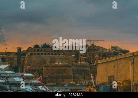 Valletta in the evening, view from Il-Birgu, Malta - Stock Photo