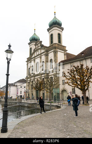 Lucerne, LU / Switzerland - November 9, 2018: tourists visit the famous Swiss city of Lucerne and take pictures of themselves with the Chapel Bridge - Stock Photo
